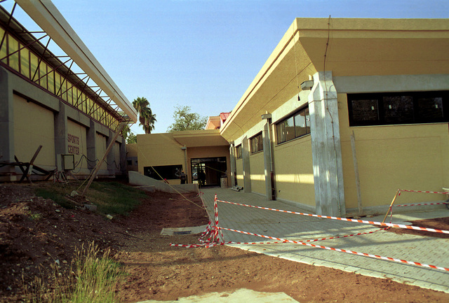 Straight on medium shot as the sports center renovation at Incirlik AB is exceeding the projected 1.13 million dollar estimate. The renovation started on 10 July 1998 and is expected to be finished in December 1999 with the grand opening slated for January 2000