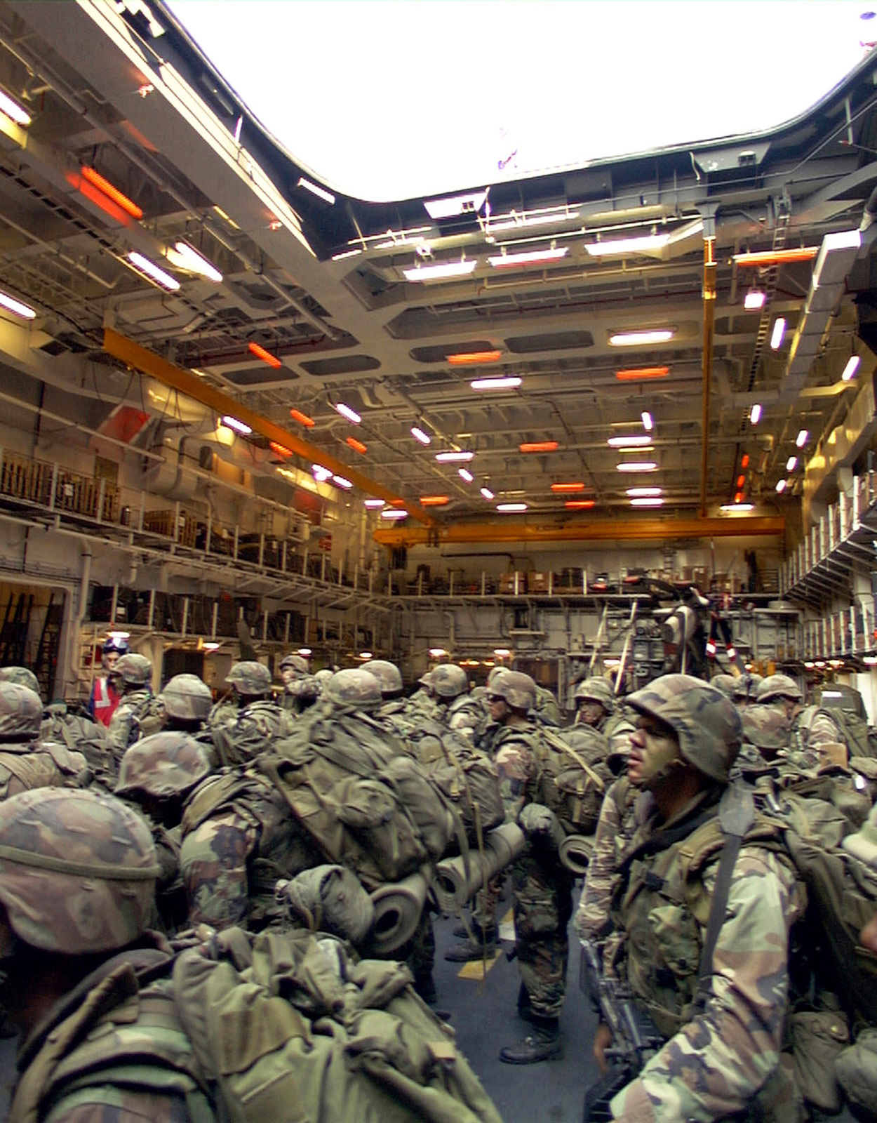 United Staes Marines from Lima Company, Battalion Landing Team 3/8, ride an elevator into the vast hangar bay of the British amphibious assault ship HMS OCEAN (L12), during NORTHERN APPROACH, a NATO exercise.Marines from the 26th Marine Expeditionary Unit (Special Operations Capable) (MEU (SOC)) are here in Turkey to participate in the NATO exercise with amphibious forces from the United Kingdom and host nation Turkey