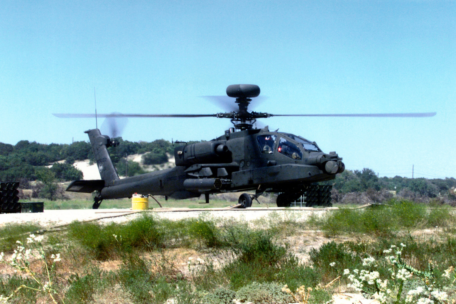 An AH-64D Apache Longbow Helicopter from the 1ST Battalion, 227th Aviation Regiment, First Cavalry Division lands at the Dalton/Henson Range Complex at Fort Hood, Texas, to reload and refuel during an annual aerial gunnery exercise. (Duplicate image, see also DDSD0108876 or search 990915A4980V022)