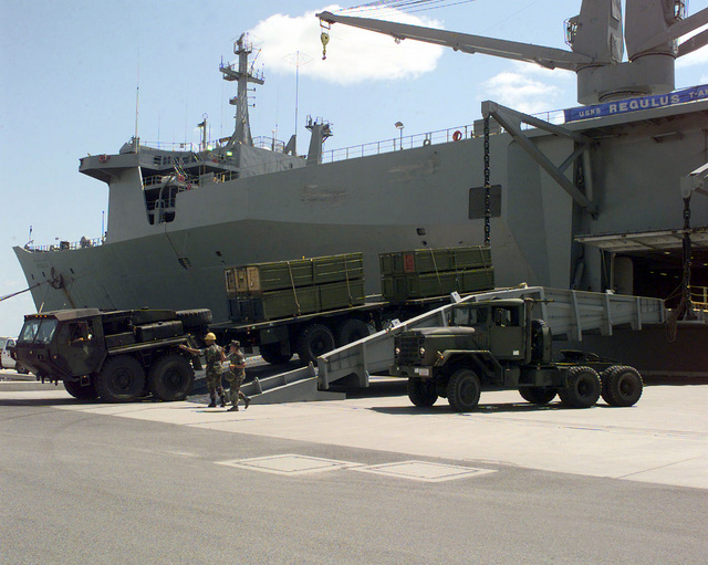 A U.S. Marine Logistic Vehicle System (LVS) is offloaded the USNS REGULUS (AKR 292) in the roll-off evolution in Auckland Port, Gladstone, Australia. An M47 dump truck sits to the right of the ramp. Members of the U.S and Australian Forces are participating in exercise Crocodile '99 in the Shoalwater Bay Training Area, Queensland, Australia