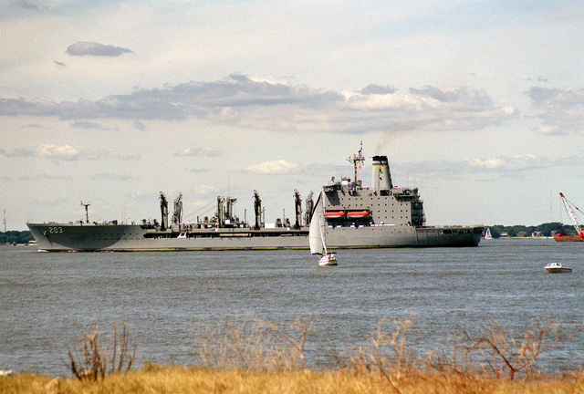 Port side view of the Henry J. Kaiser Class, Military Sealift Command (MSC), Oiler, USNS LARAMIE (T-AO 203) entering the port after returning from sea following the passage of Hurricane Floyd along the east coast. In the foreground, a privately owned small sailboat and small powerboat is seen