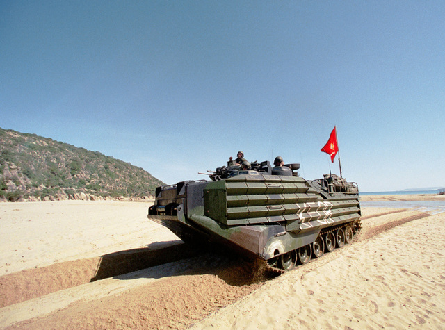 A Marine Corps Amphibious Assault Vehicle (AAV) from the 26th Marine Expeditionary Unit (Special Operations Capable) (MEU (SOC)) makes its way across the North Africa sand after making an amphibious landing at Cap Serrat, Tunisia during Exercise ATLAS HINGE