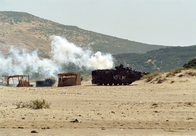 Amphibious Assault Vehicles (AAV) from the 26th Marine Expeditionary Unit (Special Operations Capable) use a smoke screen as they roll onto the beach at Cap Serrat, Tunisia during Exercise ATLAS HINGE, in a mock assault used to train Tunisian forces