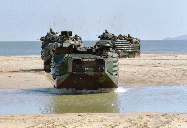 Amphibious Assault Vehicles (AAV) of the 26th Marine Expeditionary Unit (Special Operations Capable) (MEU (SOC)) splash across a sandbar at Cap Serrat, Tunisia during Exercise ATLAS HINGE in a mock amphibious assault designed to train Tunisian forces