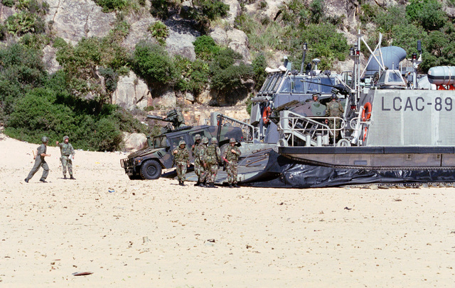 Marines from the 26th Marine Expeditionary Unit (SOC) offload vehicles from an Landing Craft, Air Cushioned (LCAC) during a mock invasion at Cap Serrat, Tunisia during Exercise ATLAS HINGE