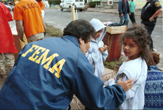 [Hurricane Floyd] BOUND BROOK, N.J., September 22, 1999 -- FEMA Community Relations worker Nora Parino talks with a young flood victim Marisa Cobb in Bound Brook, N.J. Photo by Andrea Booher/FEMA News Photo    *note - higher resolution copy of ID#369