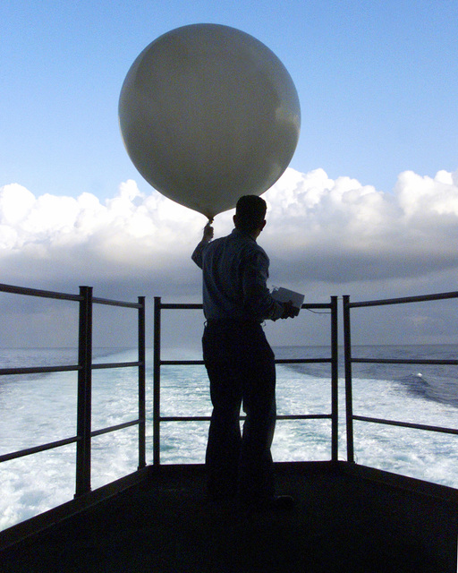 US Navy Aerographers Mate Third Class Robert Mason releases a weather balloon from the fantail of the USS HARRY S. TRUMAN (CVN 75). Aerographers Mates utilize the information from the balloon to plot wind patterns and pressure readings. Truman is conducting Carrier Qualifications (CQs) off the Virginia coast