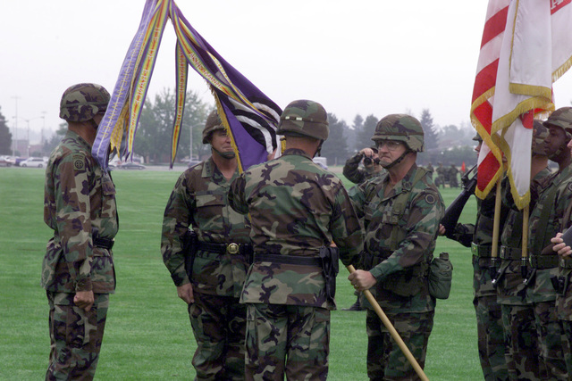 Command Sergeant Major Johnny J. Austin presents the colors to the out-going Commander, Lieutenant General George A. Crocker, during the I Corps and Fort Lewis Change of Command ceremony on 30 September 1999 at Watkins Field, Fort Lewis, Washington. LTG Crocker relinquished command to Lieutenant General James T. Hill (not shown). General Thomas A. Schwartz, Commanding General, Forces Command, (far left), is the Reviewing Officer