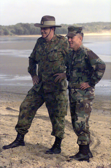 Exercise Director Brigadier Peter Kilpatrick (Left), of the Australian Defence Force (ADF), and U.S. Marine Brigadier General Gordon Nash, Deputy Exercise Director, attend an amphibious assault at Freshwater Bay inside the Shoalwater Bay Training Area, Queensland, Australia, during exercise Crocodile '99