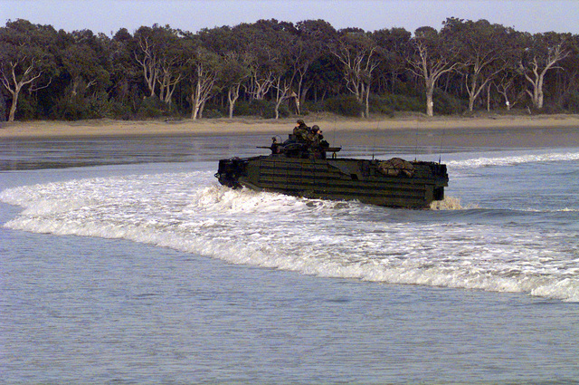 US Marines of the 31st Marine Expeditionary Unit (MEU) atop an Amphibious Assault Vehicle (AAV) perform an amphibious assault at Freshwater Bay inside the Shoalwater Bay Training Area, Queensland, Australia in support of exercise Crocodile '99