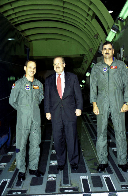 Medium shot, front view, Techincal Sergeant Bob Studley, USAF, (left) and SENIOR MASTER Sergeant Terry L. Guy, USAF, (right) with F. Whitten Peters, Secretary of the Air Force (center) in the C-17A Globemaster III simulator, Altus Air Force Base, Oklahoma