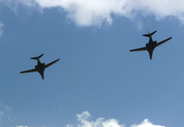 Shot of two B-1B Lancer aircraft's performing a fly over at Fort Gordon, Georgia's, Freedom Park during Freedom Fest 99. The event included drill team performances, Signal Corp Band performances, a Green Beret Sport Parachute Team demonstration, and K-9 demonstrations, among others