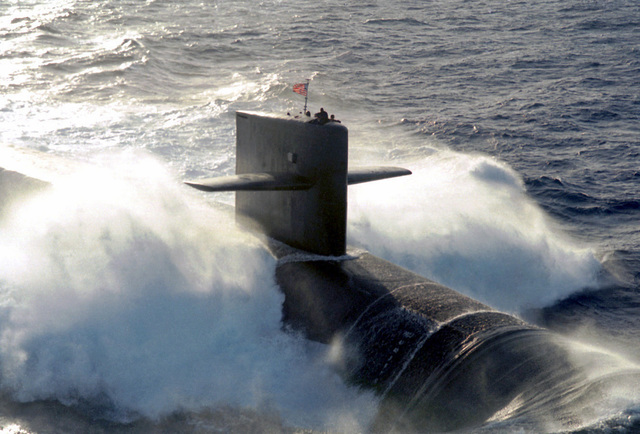 The U.S. Navy's nuclear ballistic submarine USS MAINE (SSBN-741) one of the nations newest Ohio class submarines conducts surface navigational operations approximately 50 miles due south of Naval Station Roosevelt Roads, Puerto Rico