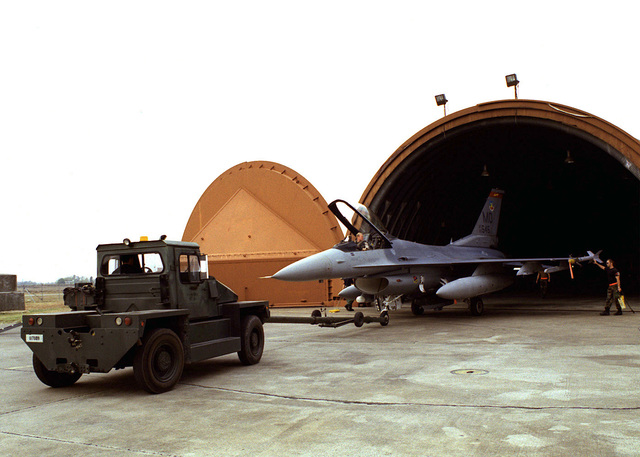 After a flight in support of Operation Northern Watch, at Incirlik Air Base, Turkey, an F-16 from the 389th Fighter Squadron, Mountain Home Air Force Base, Idaho, is pushed into a hangar for routine de-flight maintenance on November 11,1999