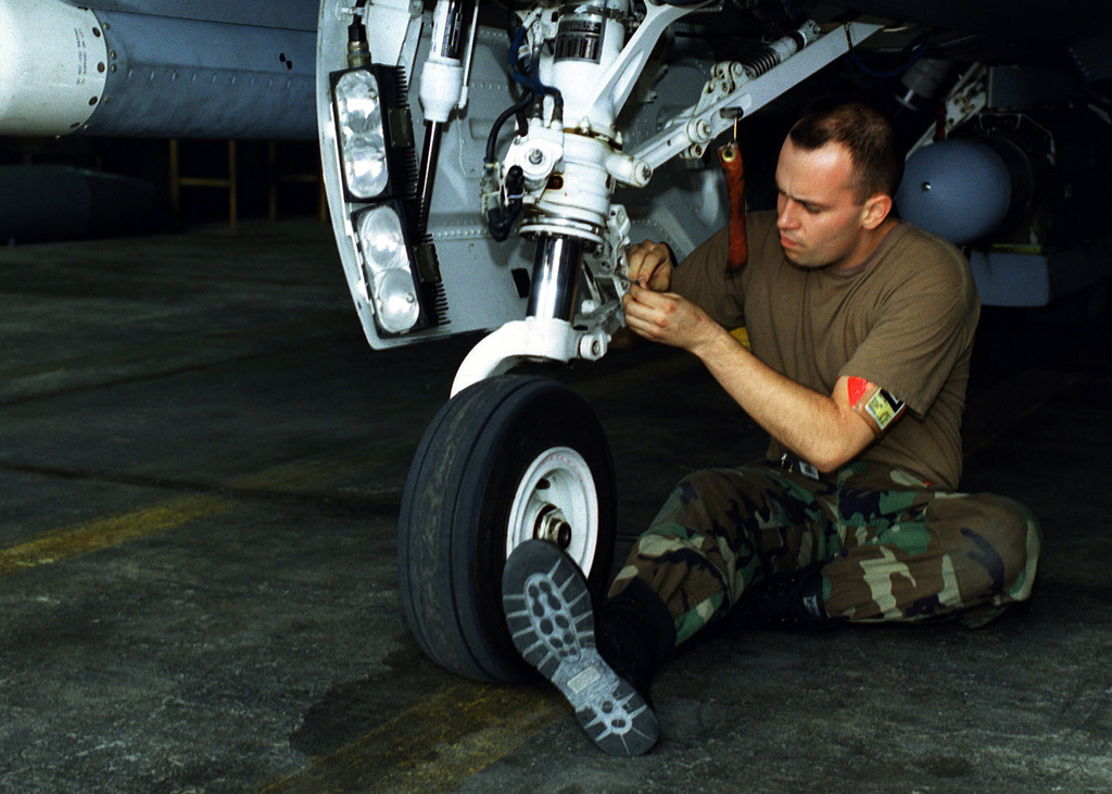 After a flight in support of Operation Northern Watch, at Incirlik Air Base, Turkey, an F-16 from the 389th Fighter Squadron, Mountain Home Air Force Base, Idaho, receives routine de-flight maintenance from AIRMAN First Class Jose Grau on November 11, 1999