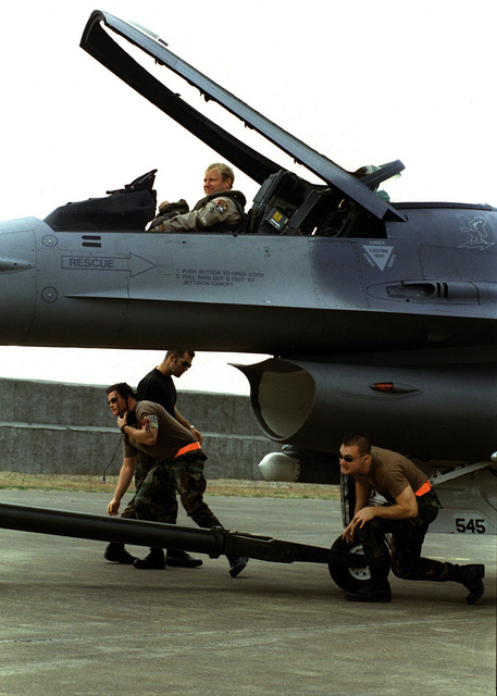 After a flight in support of Operation Northern Watch, at Incirlik Air Base, Turkey, an F-16 from the 389th Fighter Squadron, Mountain Home Air Force Base, Idaho, receives routine de-flight maintenance from STAFF Sergeant Michael Broxon, SENIOR AIRMAN Tommy Clegg, and SRA Roy Renno, November 11, 1999, while Major Patrick Ronald looks on