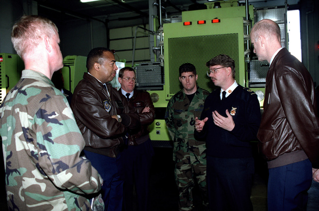 436th Civilian Engineering Fire CHIEF Don Striejewske (2nd from right) explains ventilation problems at Dover Air Force Base, Delaware to Major General John D. Hopper Jr. (2nd from left) during his two day visit on November 19, 1999. The focus was on the exhaust from the trucks when departing and returning to the building after an incident