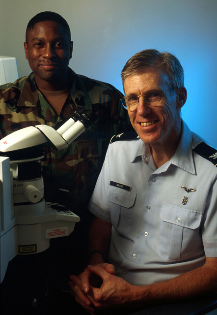 """Part of a six-person ophthalmic surgical team from Wilford Hall Medical Center, US Air Force Colonel (Dr.) Stephen Waller (right), chairman of the hospital's ophthalmology department, and US Air Force Technical Sergeant Sammie Bonner, Non-Comissioned Officer in Charge of ophthalmic services, brought years of experience and training to Costa Rica during a humanitarian mission that helped improve the vision of more than 470 patients. Their story """"Not Just Eye Wash,"""" is in the December 1999 issue of AIRMAN Magazine"""