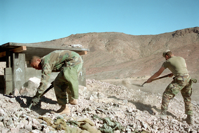 During Steel Knight 1999 held at Twentynine Palms, California, Marines from First CEB, (Combat Engineer Battalion), Bravo Company reinforce bunkers for an oncoming attack