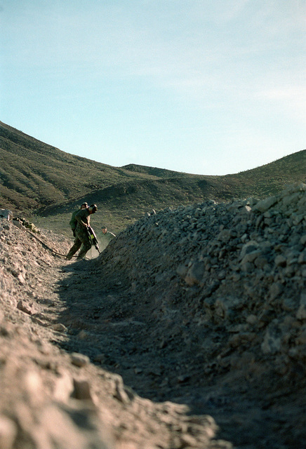 During Steel Knight 1999 held at Twentynine Palms, California, Marines from First Combat Engineering Battalion (CEB), Bravo Companydigging a trench to perfection prior to reinforce the trenches with revetments