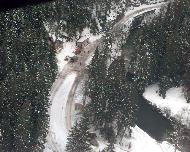 An aerial of a combined Muslim logging camp and police station