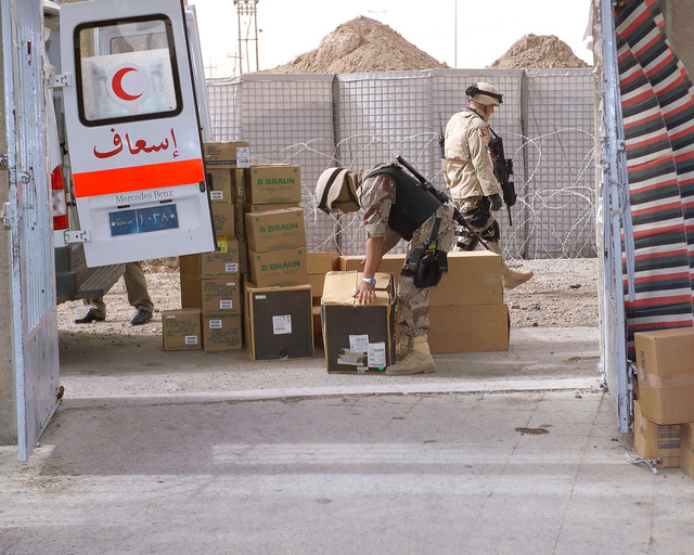 An Iraqi Army Soldier (front) unloads medical supplies at the Hadhrah Mosque, the site of an Iraqi Army controlled humanitarian assistance distribution site, in the city of Fallujah, Al Anbar Province, Iraq, on Nov. 23, 2004. Iraqi civilians are able to come to the humanitarian assistance site to receive assistance at the conclusion of the week-long battle by Multinational Forces against insurgents in the city of Fallujah, during Operation Iraqi Freedom. (U.S. Marine Corps photo by CPL. Theresa M. Medina) (Released)