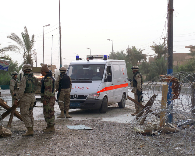 An Iraqi Red Crescent ambulance drives through a Multinational Force checkpoint outside the Hadhrah Mosque, which is the site of an Iraqi Army controlled humanitarian assistance distribution site, in the city of Fallujah, Al Anbar Province, Iraq, on Nov. 23, 2004, to deliver much needed medical supplies. Iraqi civilians are able to come to the humanitarian assistance site to receive assistance at the conclusion of the week-long battle by Multinational Forces against insurgents in the city of Fallujah, during Operation Iraqi Freedom. (U.S. Marine Corps photo by CPL. Theresa M. Medina) (Released)