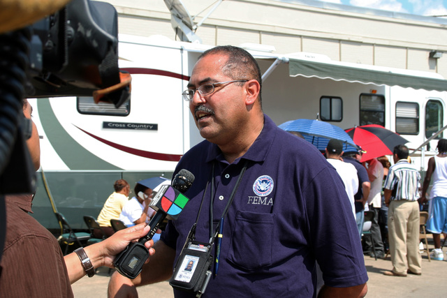 [Hurricane Ike] Houston, TX, September 20, 2008 -- FEMA Public Information Officer Alberto Pillot is interviewed by KXLN-TV, a Spanish station, at the Mobile Disaster Recovery Center on Chimney Rock Road.  FEMA has many Spanish translators at its DRCs to accommodate the large Hispanic population affected by Hurricane Ike.  Photo by Greg Henshall / FEMA