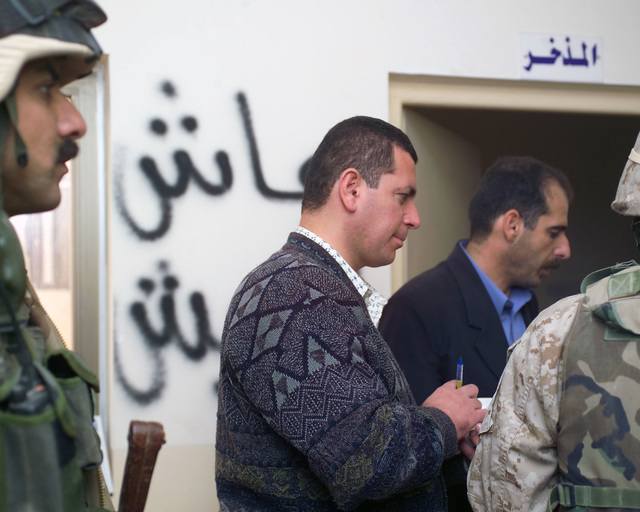 Representatives of the Iraqi Ministry of Health (center front and back), escorted by an Iraqi Army Soldier (left) and a U.S. Marine Corps Regimental Combat Team 7 (RCT-7) Marine (right), walks through the Dr. Talib Al-Janabi Hospital, in the city of Fallujah, Al Anbar Province, Iraq, on Nov. 24, 2004, to estimate what repairs are necessary to get the it back to full functionality. This assessment is being done at the conclusion of the week-long battle by Multinational Forces against insurgents in the city of Fallujah, during Operation Iraqi Freedom. (U.S. Marine Corps photo by CPL. Theresa M. Medina) (Released)