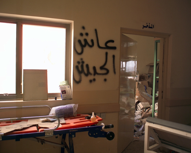 This is a hallway inside the Dr. Talib Al-Janabi Hospital, in the city of Fallujah, Al Anbar Province, Iraq, that U.S. Marine Corps Regimental Combat Team 7 (RCT-7) Marines are inspecting on Nov. 23, 2004, to estimate what repairs are necessary to get the hospital back to full functionality. This assessment is being done at the conclusion of the week-long battle by Multinational Forces against insurgents in the city of Fallujah, during Operation Iraqi Freedom. (U.S. Marine Corps photo by CPL. Theresa M. Medina) (Released)