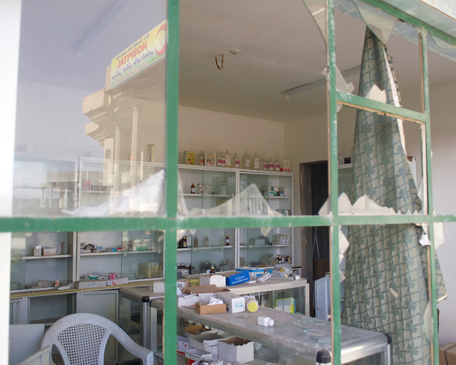 This is a pharmacy inside the Dr. Talib Al-Janabi Hospital, in the city of Fallujah, Al Anbar Province, Iraq, that U.S. Marine Corps Regimental Combat Team 7 (RCT-7) Marines are inspecting on Nov. 23, 2004, to estimate what repairs are necessary to get the hospital back to full functionality. This assessment is being done at the conclusion of the week-long battle by Multinational Forces against insurgents in the city of Fallujah, during Operation Iraqi Freedom. (U.S. Marine Corps photo by CPL. Theresa M. Medina) (Released)