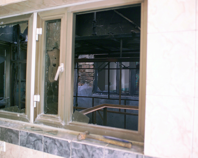 This is a reception area inside the Dr. Talib Al-Janabi Hospital, in the city of Fallujah, Al Anbar Province, Iraq, that U.S. Marine Corps Regimental Combat Team 7 (RCT-7) Marines are inspecting on Nov. 23, 2004, to estimate what repairs are necessary to get the hospital back to full functionality. This assessment is being done at the conclusion of the week-long battle by Multinational Forces against insurgents in the city of Fallujah, during Operation Iraqi Freedom. (U.S. Marine Corps photo by CPL. Theresa M. Medina) (Released)