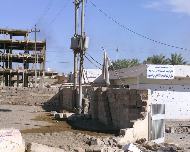 This is the Al-Jumhoria Medical Clinic, in the city of Fallujah, Al Anbar Province, Iraq, that U.S. Marine Corps 4th Civil Affairs Group Marines and Iraqi Ministry of Health representatives are inspecting on Nov. 24, 2004, to estimate what repairs are necessary to get the it back to full functionality. This assessment is being done at the conclusion of the week-long battle by Multinational Forces against insurgents in the city of Fallujah, during Operation Iraqi Freedom. (U.S. Marine Corps photo by CPL. Theresa M. Medina) (Released)