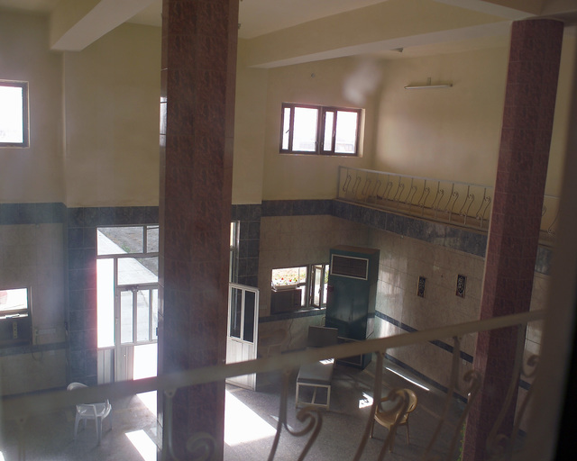 This is the main entrance area inside the Dr. Talib Al-Janabi Hospital, in the city of Fallujah, Al Anbar Province, Iraq, that U.S. Marine Corps Regimental Combat Team 7 (RCT-7) Marines are inspecting on Nov. 23, 2004, to estimate what repairs are necessary to get the hospital back to full functionality. This assessment is being done at the conclusion of the week-long battle by Multinational Forces against insurgents in the city of Fallujah, during Operation Iraqi Freedom. (U.S. Marine Corps photo by CPL. Theresa M. Medina) (Released)