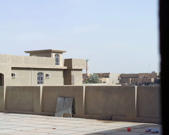 This is the roof of the Dr. Talib Al-Janabi Hospital, in the city of Fallujah, Al Anbar Province, Iraq, that U.S. Marine Corps Regimental Combat Team 7 (RCT-7) Marines are inspecting on Nov. 23, 2004, to estimate what repairs are necessary to get the hospital back to full functionality. This assessment is being done at the conclusion of the week-long battle by Multinational Forces against insurgents in the city of Fallujah, during Operation Iraqi Freedom. (U.S. Marine Corps photo by CPL. Theresa M. Medina) (Released)