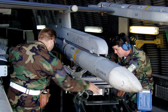 169th Fighter Wing (FW) Aircraft Generations Squadron McEntire Air National Guard (ANG) Station, South Carolina, personnel loading an AIM-120 advanced medium range air-to-air missile (AMRAAM) and other equipment onto an F-16CJ aircraft deployed at Incirlik Air Base, Turkey. The 169th FW, is deployed in support of Aerospace Expeditionary Force #4, operation Northern Watch. They are the fist ANG F-16 unit equipped with Suppression of Enemy Air and Defenses (SEAD) technology