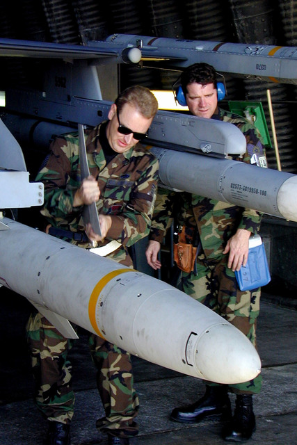 169th Fighter Wing (FW) Aircraft Generations Squadron, McEntire Air National Guard (ANG) Station, South Carolina, personnel loading muntions, including an AGM-88 HARM missile, and other equipment onto an F-16CJ aircraft deployed at Incirlik Air Base, Turkey. The 169th FW, is deployed in support of Aerospace Expeditionary Force #4, operation Northern Watch. They are the fist ANG F-16 unit equipped with Suppression of Enemy Air and Defenses (SEAD) technology