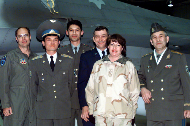 General Major Abdurakhmanov (far right), commander of the Uzbekistan Air Force and Air Defenses, and his staff along with Colonel Richard Noble (far left), commander of the 169th Fighter Wing, McEntire Air National (ANG) Guard Station, South Carolina, and CHIEF MASTER Sergeant Tina Pastore, stand in front of an F16 belonging to the 169th FW. The 169th FW is the first ANG, F-16 equipped, Suppression of Enemy Air and Defenses (SEAD) unit