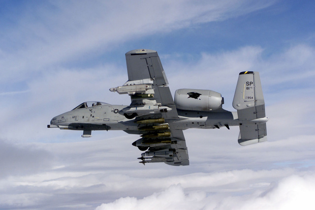 The US Air Force A-10 Thunderbolt II, flagship of the 81st Fighter Squadron, Spangdahlem Air Base, Germany, flies in the skies over northern Germany. Spangdahlem AB consists of the 81st Fighter Squadron, which flies the A-10 aircraft and two F-16 squadrons, the 22nd and 23rd Fighter Squadrons, which fly the F-16C Falcon (Not shown). The armament shown under the wings, from top to bottom, are a ALQ-119 ECM pod, the AGM-65B Maverick, four Mk 83 1000 pound general-purpose bombs, another AGM-65B and two AIM-9 Sidewinder Missiles