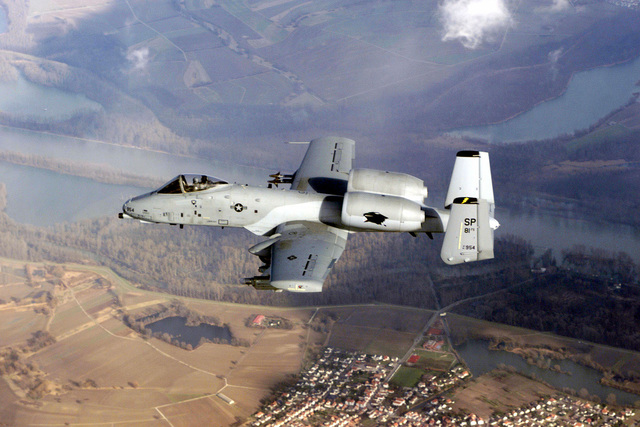 The US Air Force A-10 Thunderbolt II, flagship of the 81st Fighter Squadron, Spangdahlem Air Base, Germany flies over the Mosel River in central Germany. Spangdahlem AB consists of the 81st Fighter Squadron, which flies the A-10 aircraft, and two F-16 squadrons, the 22nd and 23rd Fighter Squadrons, which fly the F-16C Falcon (Not shown)