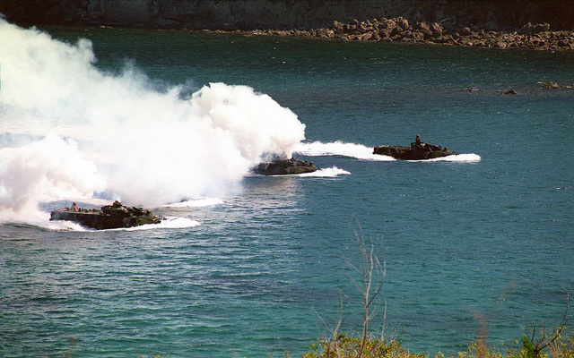USMC personnel assigned to the 3rd Amphibious Assault Battalion, 3rd Marine Division deploy smoke screens from their AAV7A1 Amphibious Assault Vehicles while conducting amphibious exercises at Marine Base Ternate during Exercise BALIKATAN 2000. BALIKATAN 2000 is a joint combined field training exercise held between US and Philippines forces, and is the largest of its kind since 1995