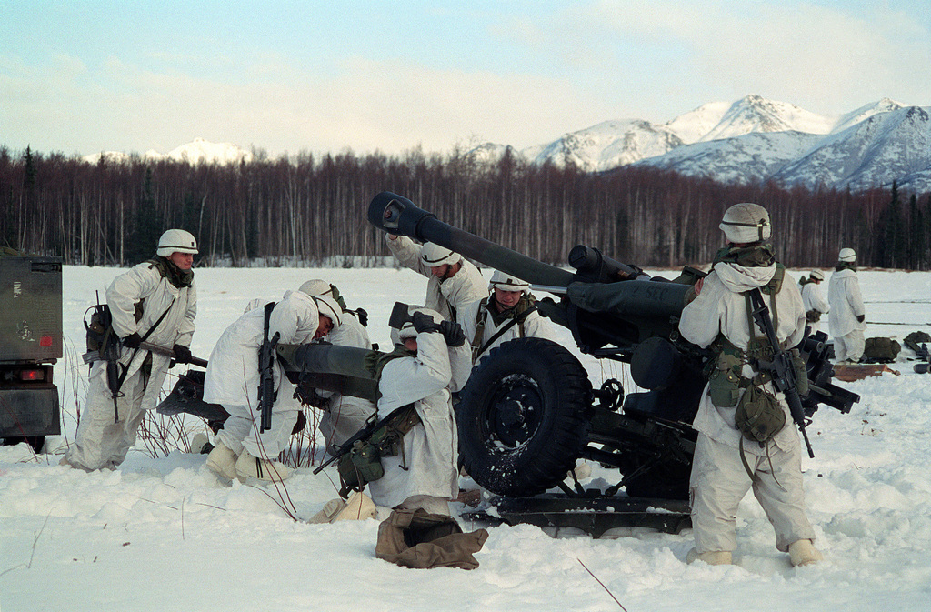 US Army Soldiers setup their M119-A1 Howitzer for support fire during Exercise NORTHERN EDGE 2000 at Elmendorf Air Force Base, Alaska