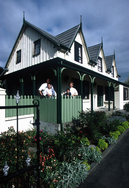 """US Air Force MASTER Sergeant Eric Davis his wife Lisa, daughter Jenny, and son Kevin stand on the porch of their home at Christchurch, New Zealand where MSGT Davis is serving a three-year special duty assignment. From the March 2000 AIRMAN Magazine article, """"The 'Kiwi' Clan"""""""