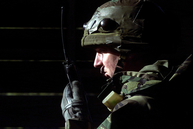 Left side profile close-up shot as US Air Force Colonel Mark Schultz radios security forces about a suspected car bomb in a local village, during a field training exercise, Monday, March 6, 2000. COL Schultz is the Operations Group Commander with 319th Air Refueling Wing, Grand Forks, North Dakota, and is deployed to the Air Mobility Warfare Center, Fort Dix, New Jersey, as Commander for the Phoenix Readiness Combat Course