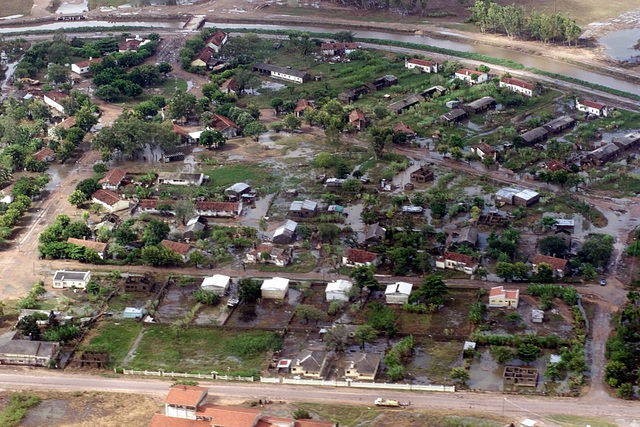Aerial view, long shot, looking down as water fills the streets of the town of Guiji near the Limpopo River in Southern Mozambique, forcing people from their homes to higher ground. C-130 aircraft (not shown) assigned to the 37th Airlift Squadron at Ramstein Air Base, Germany, fly daily Keen Sage aerial surveillance missions over Mozambique to help find stranded flood victims and survey damage caused by the flooding in Southern Africa. The 37th Airlift Squadron C-130 (not shown) aircraft are deployed to Hoedspruit Air Force Base, South Africa, as part of the United States humanitarian relief efforts