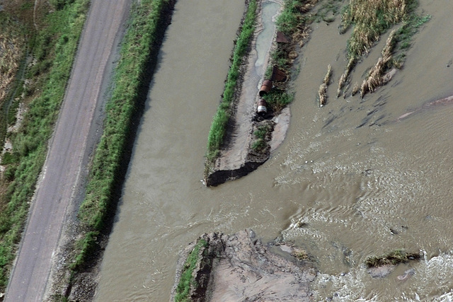 An aerial view showing flood waters, from an aqueduct cutting through its bank and spilling into the nearby fields near the town of Guiji on the Limpopo River in Southern Mozambique, South Africa. USAF personnel are deployed to South Africa to provide humanitarian relief to the people forced from their homes in the flooded regions of Mozambique, as part of Joint Task Force (JTF) ATLAS RESPONSE