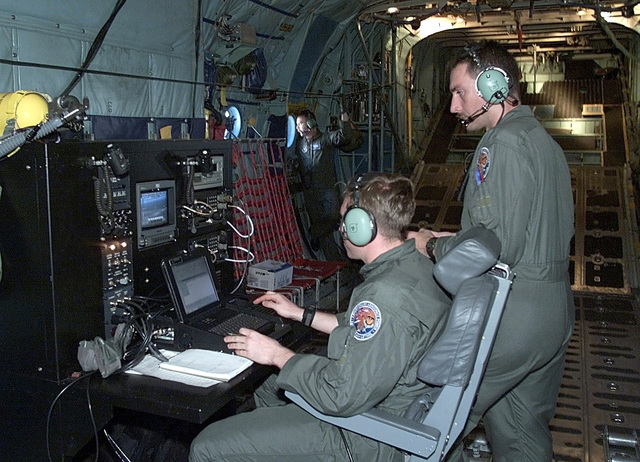 Interior, left side profile, medium shot, as USAF STAFF Sergeants Rob Turner and Todd Geehan, assigned to the 32nd Air Operations Group at Ramstein Air Base, Germany, operate a Keen Sage aerial surveillance system from a specially prepared C-130 for a flight over Southern Mozambique, to search for stranded flood victims and to survey water levels and damage (flood victims and damage not shown) caused by the recent flooding in Southern Africa. The 37th Airlift Squadron C-130 aircraft are deployed from Ramstein Air Base, Germany, to Hoedspruit Air Force Base, South Africa, as part of the United States humanitarian relief efforts Operation Atlas Response and to fly daily Keen Sage aerial ...