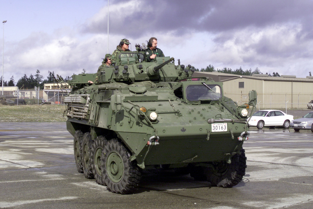 Lieutenant General James T. Hill, Commander, I Corps and Fort Lewis, drives a Light Armored Vehicle (LAV) III armored personnel carrier, on 14 March 2000. The LAV III was recently purchased and delivered to Fort Lewis, Washington, from Canada for evaluation