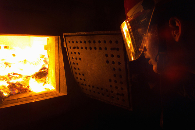 Roy Vlasuk stokes the fire to prevent damage to the incinerator from the high temperatures aboard USS Harry S. Truman (CVN-75). The incinerator is part of TRUMAN's waste management division, which is responsible for proper disposal of shipboard waste. TRUMAN is currently conducting Carrier Qualifications (CQ's) off the US Atlantic Coast while preparing for an Operational Reactor Safeguard Examination (ORSE), the ship's most significant reactor inspection, resulting in operational certification of Propulsion Plant Personnel