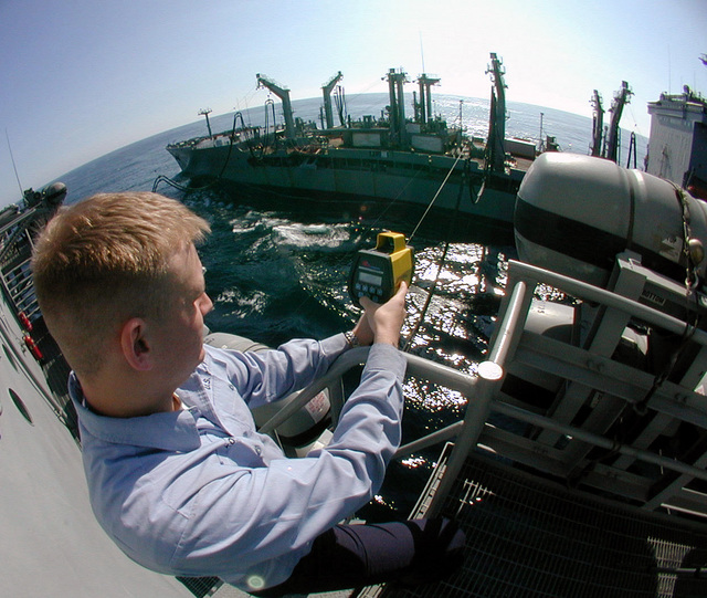 Quartermaster SEAMAN George Kopriva uses a range finder during a Refueling at Sea (RAS) to determine the distance between USNS Leroy Grumman (T-AO 195) and the USS Harry S. Truman (CVN 75). TRUMAN is currently preparing for an Operational Reactor Safeguard Examination (ORSE), the ship's most significant reactor inspection, which results in operational certification of Propulsion Plant Personnel